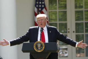 Trump, Président des USA annonçant le retrait de son pays de l'accord de Paris